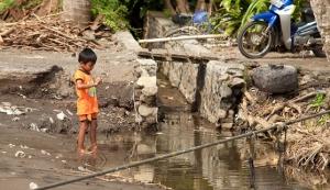 boy in dirty water